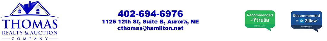 Thomas Realty, Aurora, NE Real Estate Logo